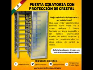 PUERTA GIRATORIA CON PROTECCIÓN DE CRISTAL